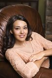 Woman sitting in chair. Royalty Free Stock Images