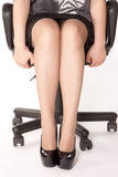Woman is sitting on the chair Stock Photos