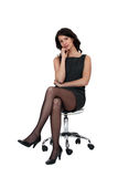 Woman sitting in chair Stock Photos