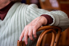 Woman sitting on a chair. Hand of an elderly woman sitting on a chair Stock Photos