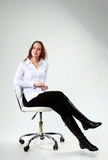 Woman sitting on the chair Stock Photography