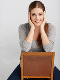 Woman sitting on chair , beautiful model . Chair back . Stock Photo