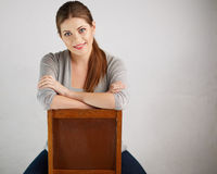 Woman sitting on chair , beautiful model . Chair back . Isolated Royalty Free Stock Image