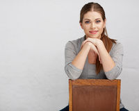 Woman sitting on chair , beautiful model . Chair back . Isolated Royalty Free Stock Photography