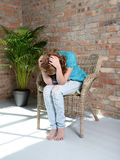 Woman sitting on the chair in depression Stock Image