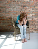Woman sitting on the chair in depression Royalty Free Stock Photos