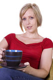 Woman Sitting on a Chair Drinking Coffee Stock Image