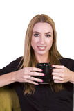 Woman Sitting on a Chair Drinking Coffee Stock Images