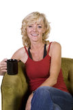 Woman Sitting on a Chair Drinking Coffee Royalty Free Stock Photos