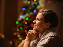 Woman sitting chair in front of Christmas tree Royalty Free Stock Photo