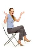 Woman sitting on chair gesturing Stock Image