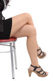 Woman sitting on chair. Image of asian business woman legs sitting on chair and white background Royalty Free Stock Photo