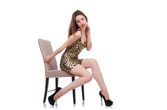 Woman sitting on the chair isolated. On white Royalty Free Stock Photos