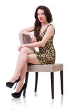Woman sitting on the chair isolated Royalty Free Stock Images