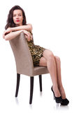 Woman sitting on the chair isolated Stock Images