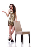 Woman sitting on the chair isolated Royalty Free Stock Photography