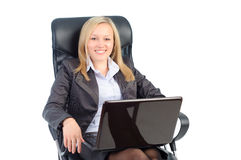 Woman sitting on a chair with a laptop in hand. Royalty Free Stock Image