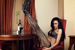 Woman sitting in a chair in lingerie Royalty Free Stock Photography