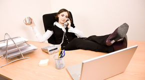 Woman sitting in the chair and talking on phone Stock Images