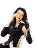 Woman sitting on chair and talking on the phone Stock Photos