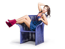 Woman sitting on a chair Royalty Free Stock Photography