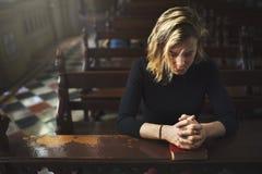Woman Sitting Church Religion Concept. Woman Praying at the Church Religion Concept Stock Images