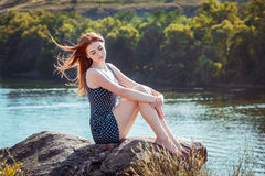 Woman sitting on the cliff Royalty Free Stock Images