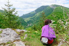 Woman sitting on cliff Stock Photography