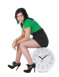 Woman sitting on clock Stock Images