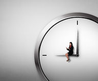Woman Sitting On The Clock Using Tablet Royalty Free Stock Photo