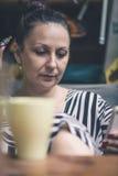 Woman sitting close up stock photo
