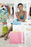 Woman Sitting In A Clothes Shop Royalty Free Stock Image