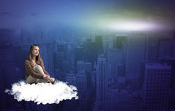 Woman sitting on cloud above the city stock illustration