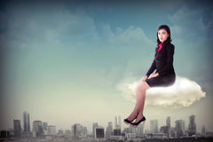 Woman Sitting On The Cloud Stock Photo
