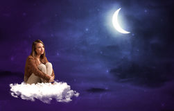 Woman sitting on cloud Stock Photos