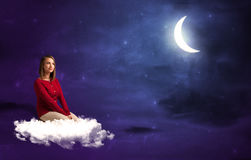 Woman sitting on cloud Royalty Free Stock Photo