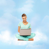 Woman sitting on the cloud with laptop Royalty Free Stock Image
