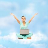Woman sitting on the cloud with laptop Stock Photo