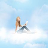 Woman sitting on the cloud with laptop Royalty Free Stock Photography