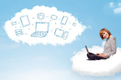 Woman sitting in cloud with laptop Stock Images
