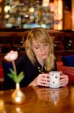 Woman sitting with coffee Stock Images
