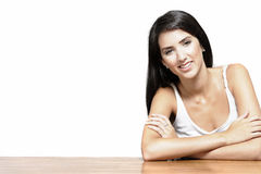 Woman sitting at coffee table Royalty Free Stock Image