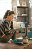 Woman sitting on coffee table in loft apartment Royalty Free Stock Photography