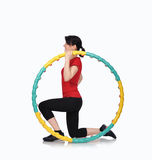 Woman sitting with color hula hoop Stock Images