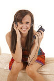 Woman sitting colorful dress facing headphones Stock Photo