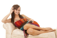 Woman sitting colorful dress side headphones listen Royalty Free Stock Photography