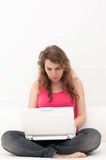 Woman sitting comfortable with laptop Royalty Free Stock Photos