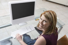 Woman Sitting At Computer Stock Photos