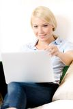 Woman sitting with computer Stock Image