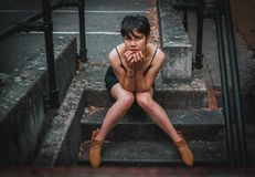 Woman Sitting on Concrete Stairs royalty free stock photo